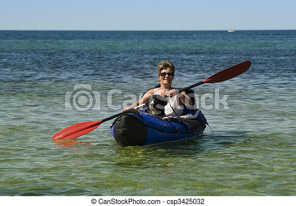 kayak woman and dog kayak woman and dog seen almost from the front