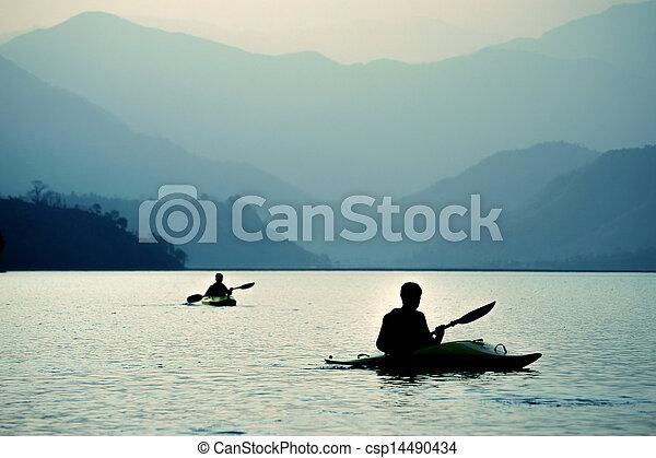 Kayaking at sunset in the mountains - csp14490434