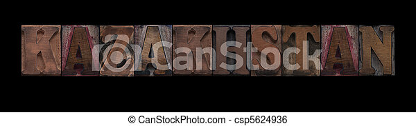 Kazakhstan in old wood type - csp5624936