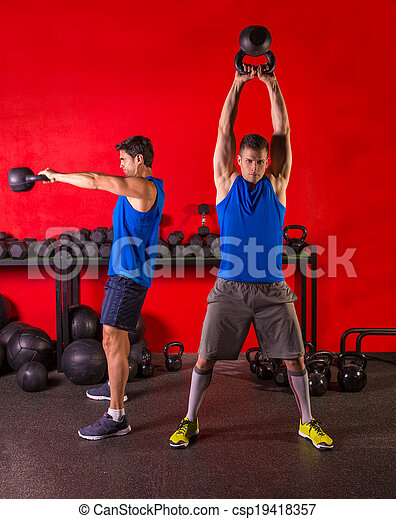 Kettlebell swing workout training group at gym - csp19418357