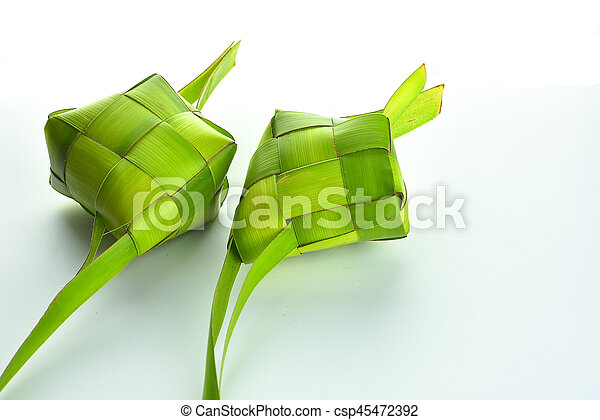 Ketupat (Rice Dumpling). Ketupat is a natural rice casing made from young coconut leaves for cooking rice during eid Mubarak - csp45472392