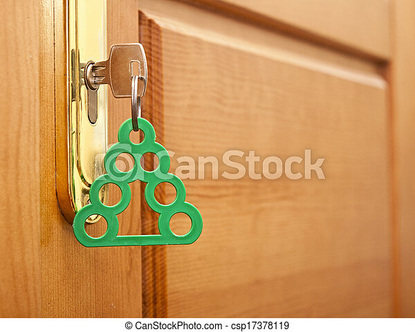 key in keyhole with blank tag in the form of a Christmas tree - csp17378119