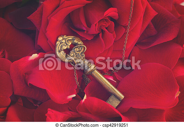 Key with the heart as a symbol of love - csp42919251