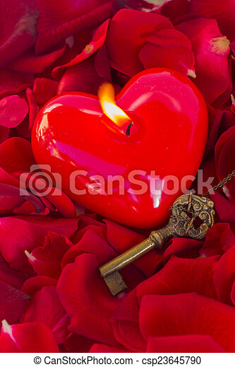 Key with the heart as a symbol of love - csp23645790
