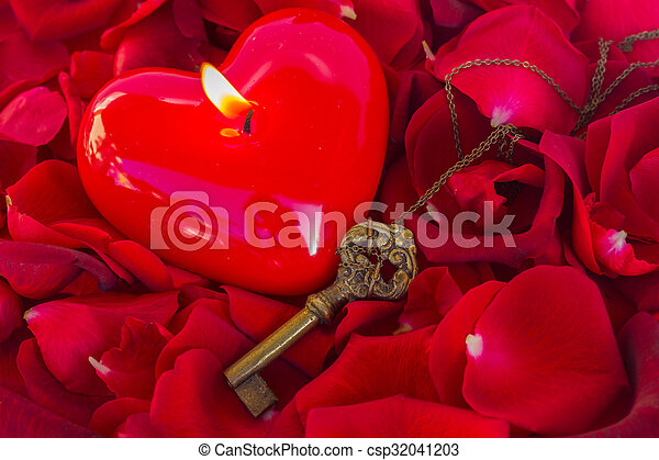 Key with the heart as a symbol of love - csp32041203