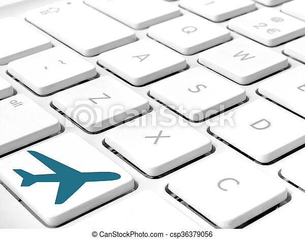 Keyboard White Keys Close Up With Blue Airplane Symbol On Lower Key