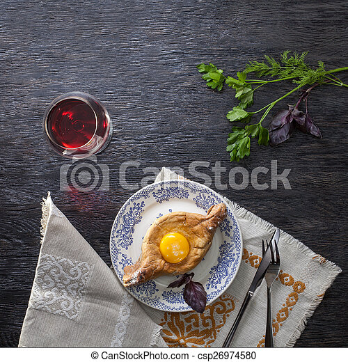 Khachapuri on plate with herbs - csp26974580