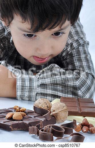Kid and chocolate nut - csp8510767