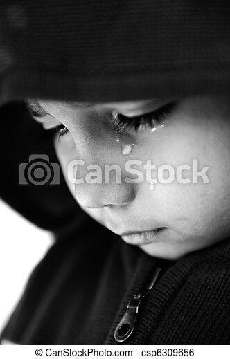 Kid crying, focus on his tear, added a bit of grain, black and white - csp6309656