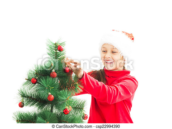 kid decorate the Christmas tree Christmas toys on a white backgr - csp22994390