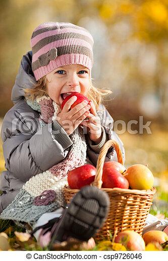 Kid eating red apple - csp9726046