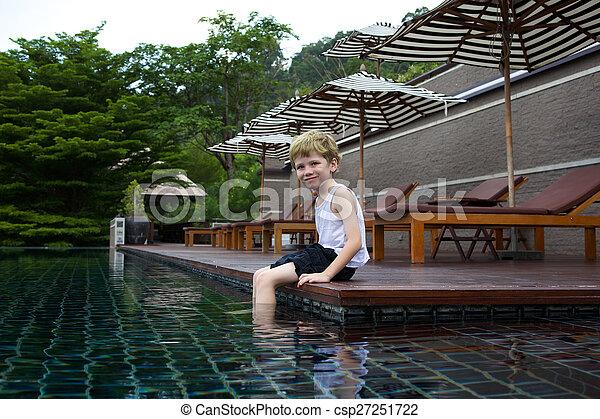 Kid enjoying the pool. - csp27251722