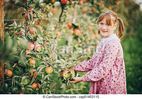 cb51e400e72 Kid girl playing in apple orchard
