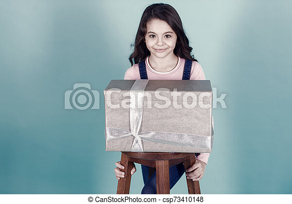 Kid girl with present gift box - csp73410148