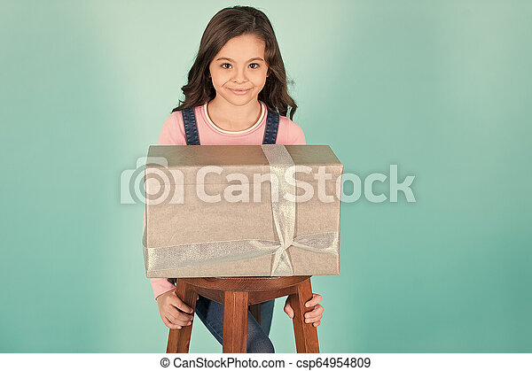 Kid girl with present gift box - csp64954809