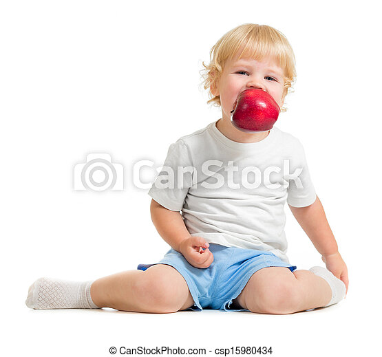 kid keeping apple in mouth - csp15980434