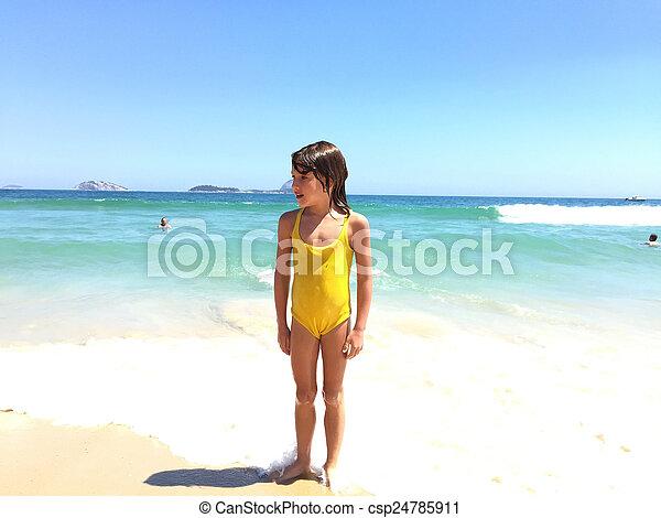 Kid on tropical beach - csp24785911