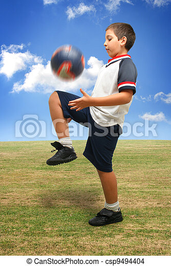 Kid playing soccer outside - csp9494404