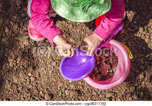 Kid playing with dirt - csp36311192