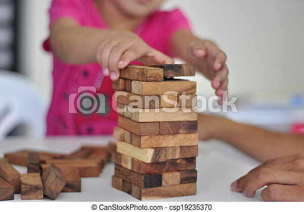 kid playing with wooden blocks - csp19235370