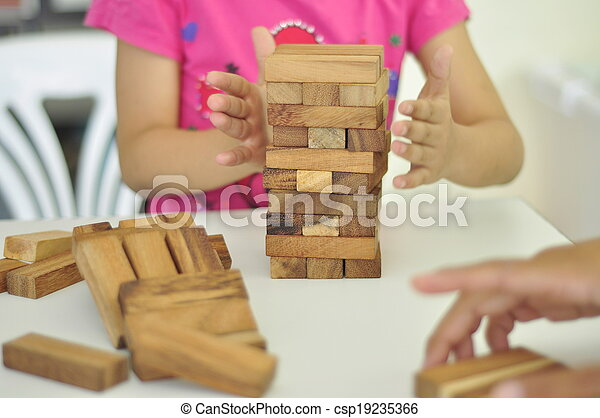 kid playing with wooden blocks - csp19235366