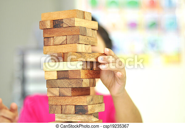 kid playing with wooden blocks - csp19235367