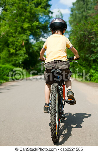 Kid riding bicycle - csp2321565