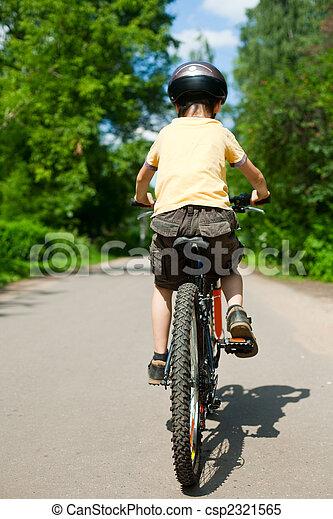 Kid riding bicycle - csp2321565