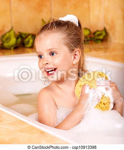 Kid washing in bath. Child washing in bubble bath . stock ...