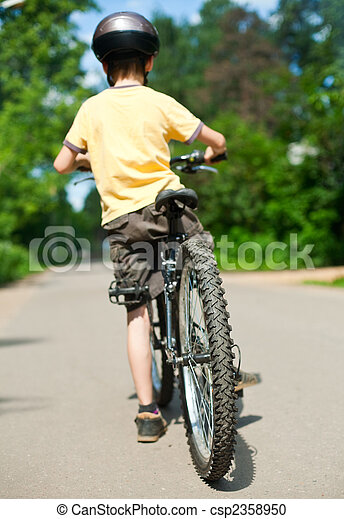 Kid with bicycle - csp2358950