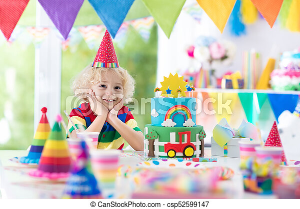 Kids Birthday Party Child Blowing Out Cake Candle Kids Birthday Party Child Blowing Out Candles On Colorful Cake