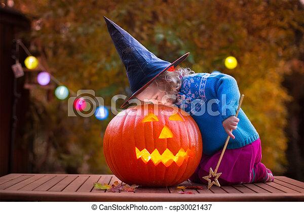 Kids carving pumpkin at Halloween - csp30021437
