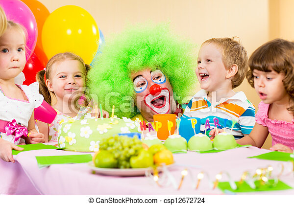 kids celebrating birthday party with clown - csp12672724