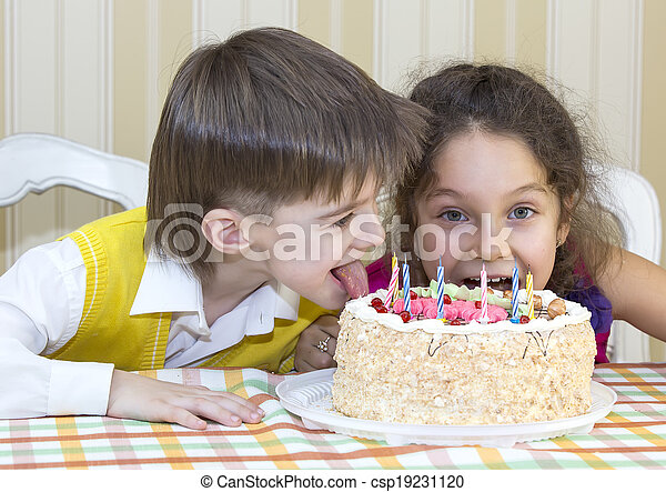 Kids eat cake Kids have fun eating birthday cake stock photo