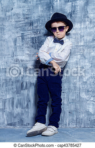722873a82 Kids fashion. Cute little boy in elegant clothes and sunglasses. be ...