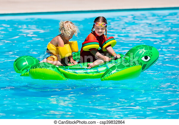 Kids in swimming pool with inflatable toy