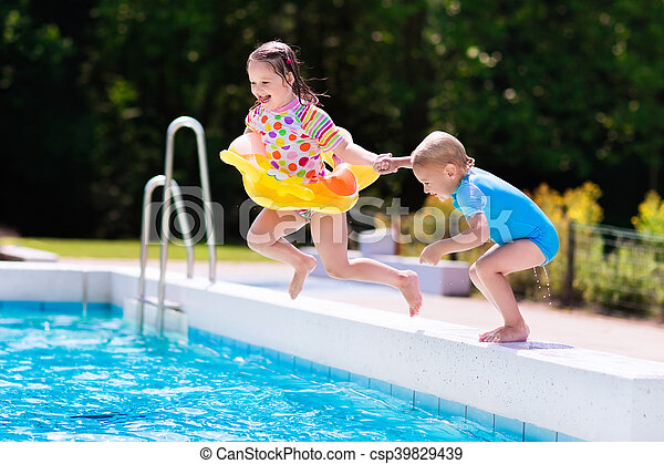 Kids Jumping Into Swimming Pool Happy Little Girl And Boy Holding Hands Jumping Into Outdoor