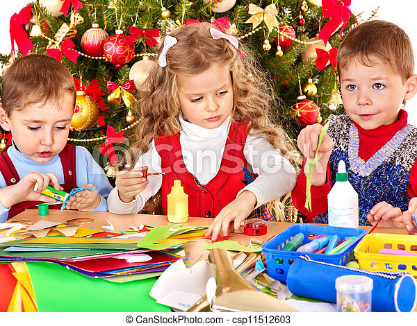 Kids making decoration for Christmas. - csp11512603