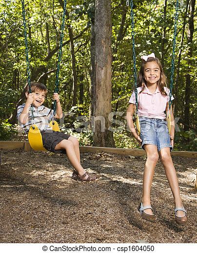 Kids on swing set. - csp1604050