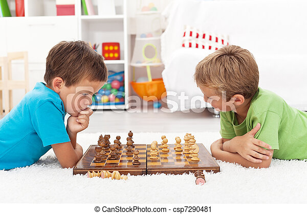 Kids playing chess - csp7290481