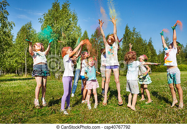 Kids playing with colored powder at outdoor fest - csp40767792