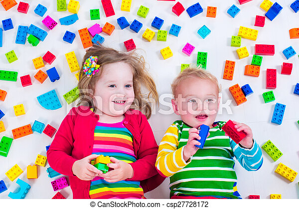 Kids playing with colorful blocks - csp27728172