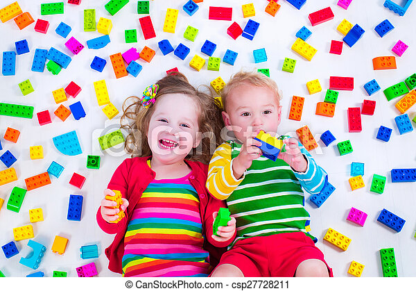 Kids playing with colorful blocks - csp27728211