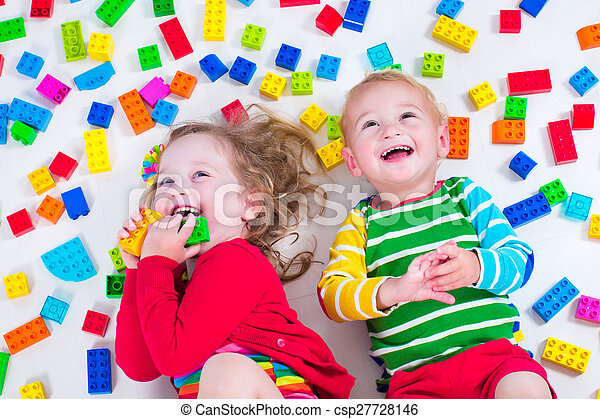 Kids playing with colorful blocks - csp27728146