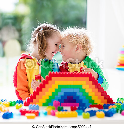 Kids playing with colorful blocks - csp45003447