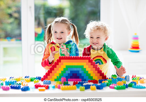Kids playing with colorful blocks - csp45003525