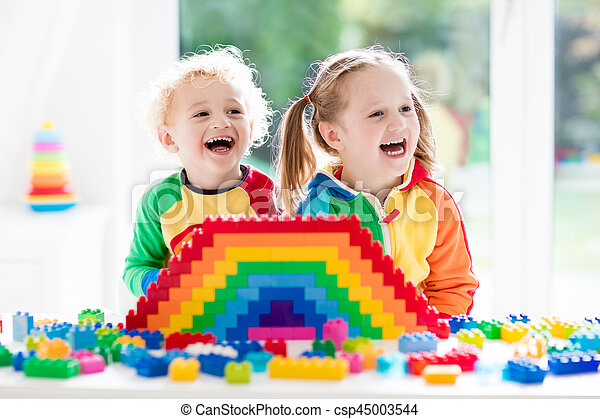 Kids playing with colorful blocks - csp45003544