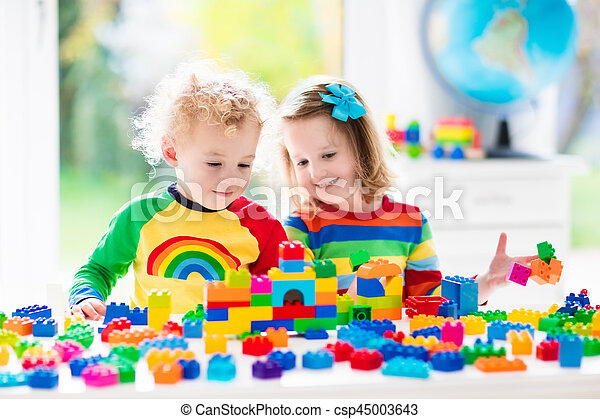 Kids playing with colorful blocks - csp45003643