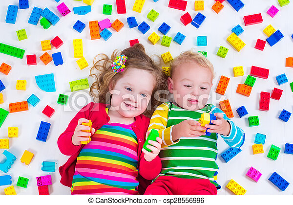 Kids playing with colorful blocks - csp28556996