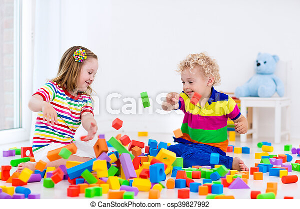 Kids playing with colorful blocks. - csp39827992